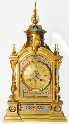 Tiffany & Co. champleve clock with cherubs.
