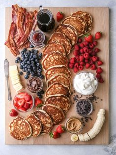 "This fun and creative ""build your own"" pancake board with all the toppings is perfect for breakfast, brunch, and even brinner! This fun and creative ""build your own"" pancake board with all the toppings is perfect for breakfast, brunch, and even brinner! Brunch Recipes, Breakfast Recipes, Pancake Breakfast, Breakfast Platter, Breakfast And Brunch, Breakfast Buffet, Fun Breakfast Ideas, Pancake Bar, Pancake Ideas"