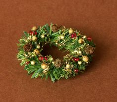 Natural Looking Miniature Christmas Wreath for Your Dollhouse by DinkyWorld at Etsy
