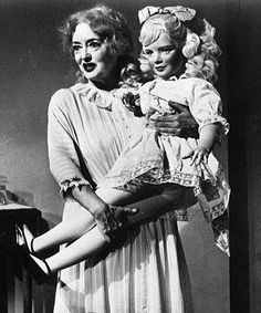 """What Ever Happened to Baby Jane? (1962). - shown are """"Baby Jane"""" (Bette Davis) and the Baby Jane doll"""