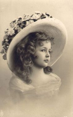 Vintage Girl In Hat Accessorized With Flowers.