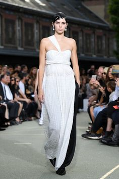 Pin for Later: The Women Ruled the Runway at Givenchy's Men's Show Kendall Jenner was right on theme. The supermodel took the catwalk in a crisp white one-shouldered gown with a sleek stripe of black.