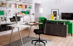 A home office inside the living room consisting of a desk with white table top and silver-coloured steel legs, a dark grey swivel chair on castors and storage in white and grey.