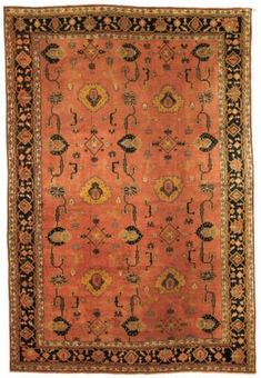 USHAK CARPET  WEST ANATOLIA, CIRCA 1900  The salmon-pink field with stylised palmettes and angular flowering vine meander, angular floral sprays and minor motifs in a medium blue shaded border of turtle-palmette and angular flowering vine between floral and ribbon stripes, areas of repiling 19ft.3in. x 12ft.11in. (585cm. x 394cm.)
