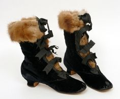 1862 black velvet boots lined and trimmed with fur, opening up front tied with five black ribbon bows.  Belonged to Empress Eugenie.