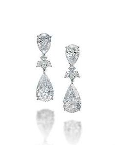 A PAIR OF DIAMOND EAR PENDANTS Each set with a pear-shaped Internally Flawless diamond, weighing 10.25 and 10.01 carats, and an inverted pear-shaped Internally Flawless diamond surmount, weighing 5.02 and 5.00 carats, to the marquise-shaped and brilliant-cut diamond spacer, mounted in gold.
