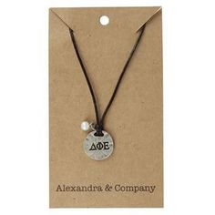 "Sisters Delta Phi Epsilon Necklace. Lovely stamped charm on brown leather cording. Zinc alloy charm has Greek Letters stamped on front with ""Sisters are Forever"" stamped on back with a dainty bead tha"