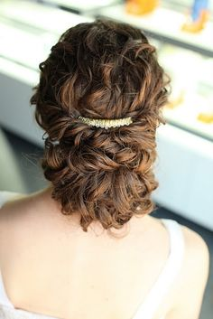 Beautiful romantic updo with simple and elegant headpiece
