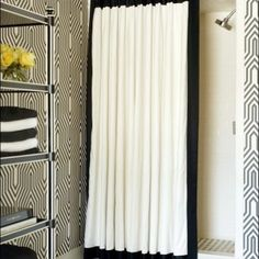Chic Black And White Shower Curtain Target for Modern Bathroom & Attractive Line Patterned Wall and White Ceiling & Big Cabinet for Towels and Other Products & Black and White Carpet on the Floor