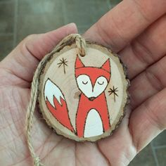 Wood slice Christmas fox ornament, hand painted and wood burned onto a pretty wood slice. Can be personalized on the back. If you are interested in that option, please let me know in the note to seller section during check out what wording you would like added. Please keep in mind I have limited space to work with, but its easy to add a name and year, Merry Christmas 2016 etc. Please just convo me if you have questions! All of my wood burnings originate from a free hand drawing in pencil…