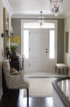Add moulding around front door to make grander....instead of windows, add mirrors?
