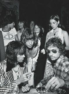 Keith Richards, Mick Jagger, and Bob Dylan at Jagger's 29th birthday party, July 1973. Photo by Ken Regan.