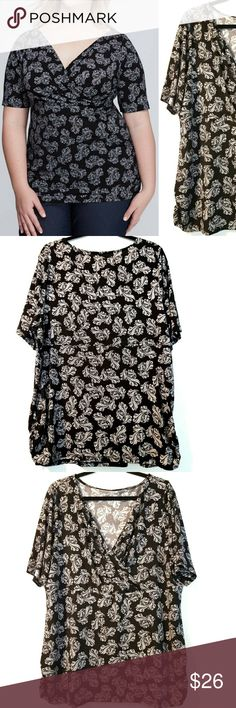 """Lane Bryant 22/24 Black Surplice Top NWT This Lane Bryant 22/24 Black Surplice Top is NEW with Tag. Stretchy, but close-fitting. Bust measures 24"""" across laying flat measured from pit to pit so 48"""" around unstretched. 30"""" long. Side ruching. NEW! ::: Bundle and save! ::: No trades. ::: Model pic from LaneBryant.com Lane Bryant Tops"""