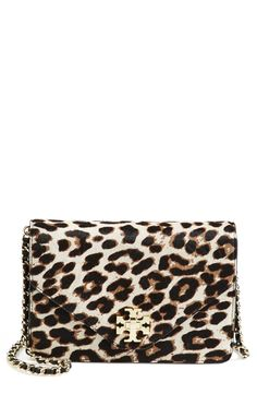 Wild about this Tory Burch leopard print crossbody bag with gold details.