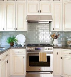 Uplifting Kitchen Remodeling Choosing Your New Kitchen Cabinets Ideas. Delightful Kitchen Remodeling Choosing Your New Kitchen Cabinets Ideas. Cream Colored Kitchen Cabinets, White Kitchen Backsplash, Kitchen Cabinets Decor, Farmhouse Kitchen Cabinets, Cottage Kitchens, Kitchen Cabinet Colors, Kitchen Paint, Kitchen Colors, New Kitchen