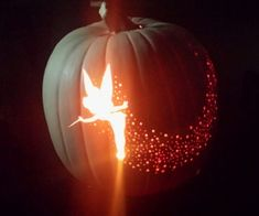 Tinker Bell Pixie Dust Pumpkin Carving - trace Tinker Bell image to pumpkin, cut out; use different drill bits to create pixie dust! <> (Halloween, All Hallow's Eve, October jack-o-lantern) Halloween Pumpkins, Halloween Crafts, Holiday Crafts, Holiday Fun, Halloween Decorations, Halloween Party, Halloween 2015, Disney Halloween, Zucca Halloween