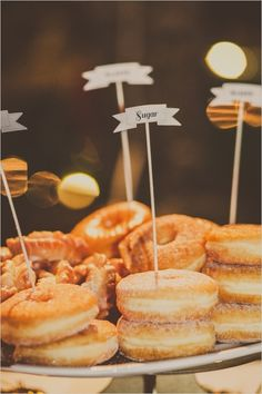 donut flags and donuts as wedding reception treats. Doughnut Wedding Cake, Wedding Donuts, Wedding Sweets, Wedding Cakes, Brunch Wedding, Wedding Reception, Dessert Bars, Dessert Table, Donut Bar