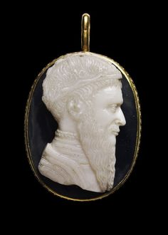 Cameo; onyx; bust of king to right, with long forked beard, resembles Scanderbeg; wears coat over vest with high collar; on head is crown with two arches and fleur-de-lis in middle; in more recent gold pendant mount. Date:      15thC - Italy