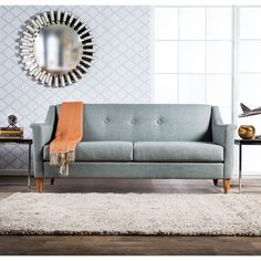 This flared modern sofa offers comfort and style to fit any home setting. Offered in three colors, the sofa takes it back a few decades while the smooth fabric encases plush, high-density foam cushions and a solid wood frame within.