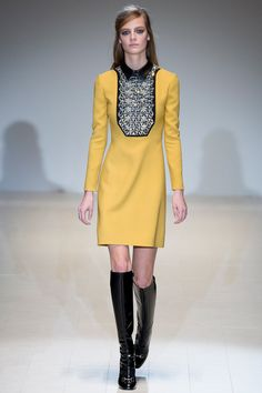 Yellow long-sleeve dress with black leather collar and bib of crystals paired with black horsebit loafer boots by @gucci. #IStyleNY #Style