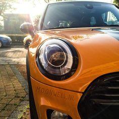 My orange baby! F55 Mini Cooper with JCW exterior. Volcanic Orange and striping