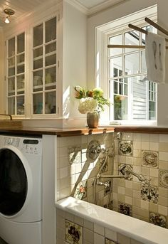 Pet area/Laundry Room -  This laundry space incorporates a custom dog shower, handy if you have the square footage. But you don't have to be that fancy. Just add a comfy dog bed, litter box or other designated area for your furry family members.