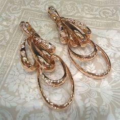 Diamond studded gold hoop earrings from De Grisogono