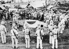 The Invasion of the Marianas Islands, June - August 1944: American soldiers lower the coffin containing the body of Lieutenant General Saito Yoghitsugu into a makeshift grave on Saipan. General Saito, together with Vice Admiral Nagumo Chuichi, had committed suicide to avoid capture.
