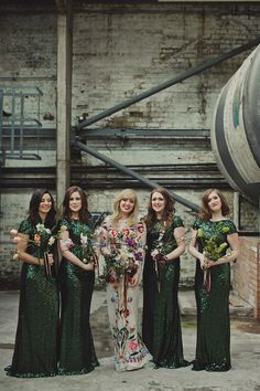 Gillian wore a colourful embroidered long sleeved gown by Temperley for her modern and alternative Woodside Warehouse wedding in Glasgow. Photography by Dan O'Day.