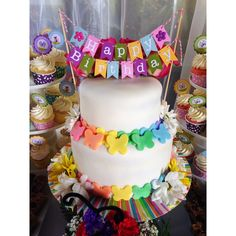 """Beautiful butterfly Garden Party cake! Love the mini """"happy birthday"""" cake bunting! See more party ideas at CatchMyParty.com. #butterflies #girlbirthday #birthdaycake"""