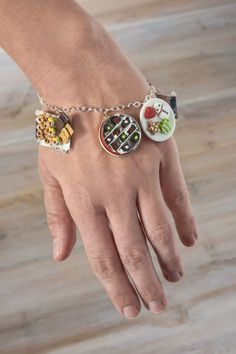 Create some unique jewelry to go along with your ugly Christmas sweater! This candy bracelet and ring was made with holiday miniatures. So easy to make! Candy Bracelet, Bracelet Watch, Cuff Bracelets, Christmas Arts And Crafts, Diy Christmas Gifts, Christmas Things, Making Ugly Christmas Sweaters, Beaded Jewelry, Unique Jewelry