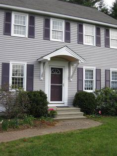 Overhang/canopy/awning/hood over front door.