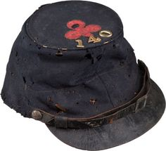 Forage Cap with 1st Division 2nd Corps Badge 140th Pa. The cap was used by John F. Wilson. He was mustered into Company G, 140th PA Infantry August 22, 1862, promoted to 1st Sergeant May 4 1863, 2nd Lieut Sept 1 1863, Capt Dec 10 1864. Wounded at Gettysburg July 2 1863. Died at City Point VA, April 14 1865, from wounds received at Petersburg March 25, 1865. The 140th PA Infantry served with the Middle Department and with the Army of the Potomac.