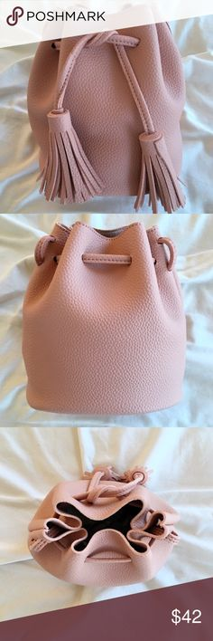 """New! Blush Bucket Bag Pebble Vegan Leather Tassels New! Blush Bucket Bag with Tassels. Vegan Pebble Leather. Size: 7.5""""L x 5.5""""W x 7.75""""H. Drawing Closure. No Trades. Price is Firm Unless Bundled. GlamVault Bags Crossbody Bags"""