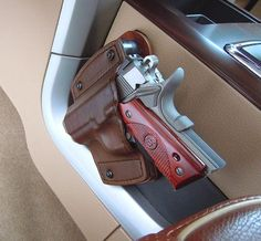 "All of our leather holsters mount in your car, home, safe, bag, box, office or anywhere you can imagine. Screw mounts solidly in place keeping your firearm safe and exactly where you want with no unwanted movement. * All pictures are representative. Your gun holster will be made to order by your choices above. Gun holster is open ended and measures 5.5"" x 5.5"". ** Choosing the correct mounting position determines which way we press the handgun holster (left, right). If you have any…"