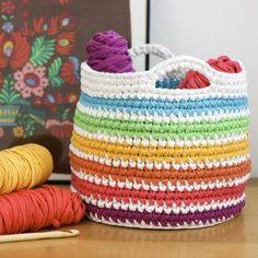 Make a colorful crocheted basket out of recycled t-shirt yarn with this easy…