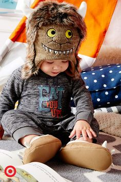 "Nothing is sweeter than your little monster! ""Where the Wild Things Are"" baby boy apparel is nothing short of adorable—from the furry monster hat all the way down to the tiny monster feet! He'll be ready to romp and play in it from morning 'til night… but just remember, monsters need naps, too!"