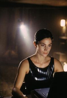 """The Matrix, 1999. Carrie-Anne Moss. """"I sent two agents; they're bringing her down now."""" """"No leutenant your men are already dead."""" Watched this classic last night."""