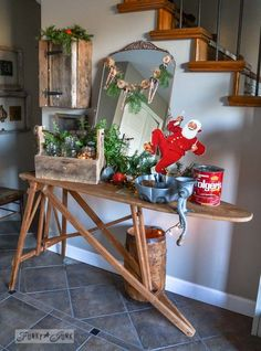 Vintage ironing board entry table / Funky Junk Interiors Christmas Home Tour 2013 via http://www.funkyjunkinteriors.net/ #easyholidayideas