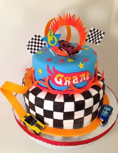 Cakes by Kirsten Race car theme cake with loops, ring of fire and flag theme. Marbled cake with vanilla buttercream. wheels cake car cake of fire car cake 5th Birthday Cake, Cars Birthday Parties, Boy Birthday, Birthday Ideas, Hot Wheels Cake, Hot Wheels Party, Cars Theme Cake, Cakes For Boys, Boy Cakes