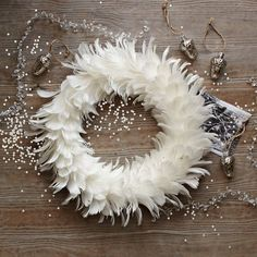 Decorate the tree and have a white Christmas with this feather wreath! On sale for just $15 and FREE shipping!