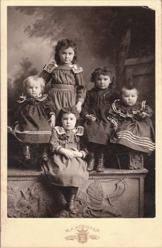 Vintage cabinet card of five siblings