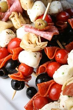 Antipasto kabobs. Great party food!    1  9 oz package of Three Cheese Tortellini ,(I used Buitoni )cooked to package directions  1 can Medium or Large pitted Black Olives  1 5.75 oz jar Green Olives  2 12 oz containers of marinated mozzarella balls  30 slices of Salami, cut in half  60 pieces of pepperoni  1 cup Balsamic Vinaigrette Salad Dressing (store bought or homemade  60 Skewers