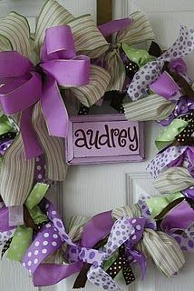 Love this. It is for a baby door but it would be cute with your last name and spring colors.