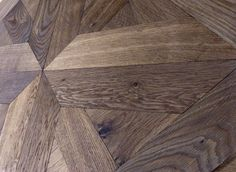 The presence of knots and cracks on the surface of the wood emphasizes its natural appeal. #artisticparquet #chevronparquet #floor #floors #hardwoodflorboards #intarsia #lehofloors #luxparquet #modularparquet #parquet #studioparquet #tavolini #tavolinifloors #tavolinifloorscom #tavoliniwood #termowood #wood #woodcarpets #woodenfloors #iloveparquet #designinterior #tavolini #tavolinifloors #tavolinifloorscom #module #modularparquet #pattern