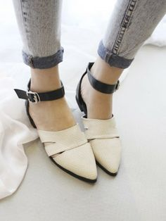 pointed snakeskin print flats.