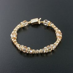 "Champagne Bracelet with Graduated Swarovski Crystals.  7.5"" long.  Assembled in USA."