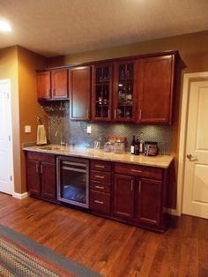 Cabinets: Aristokraft Avalon Maple Rouge  Granite Level 1 w/ 1 sink cut out  Selected - Level B Kashmir Cream Polished Edge: Square/Straight   Backsplash: Glass Mosaic Brick Pattern  Grout: Desert Sand