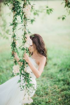 Romantic rose and jasmine covered wedding swing | Kovchegin and Romanova Photography | see more on: http://burnettsboards.com/2015/11/romantic-portrait-session/