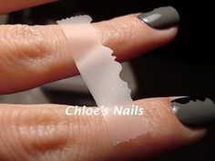 Paint nails a base color (photo: grey) let dry. Then grab some scotch tape and craft scissors, cut a design along an edge of the tape, tape to your fingernail and apply a second color (picture: black) and you have instant fancy nails!